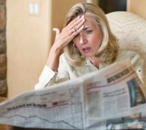 Woman reading the business section of the newspaper