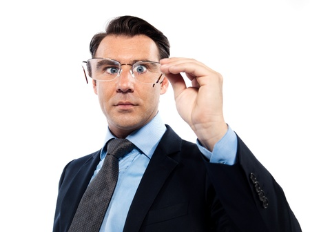 Man holding his magnifying eyeglasses in front of his face, attempting to pear into the future